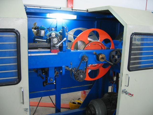 LAPPING AND TAPING MACHINES - TANGENTIAL TAPING MACHINE